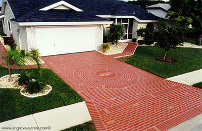 Image of a driveway with a brick pattern.