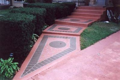 Image of a walkway and steps with a quarry tile pattern.