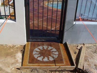 Image of western sun on concrete stoop.