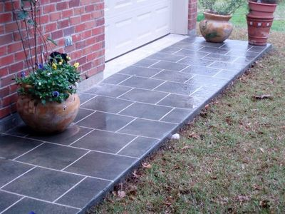 Image of acrylic stained walkway with a square tile pattern.