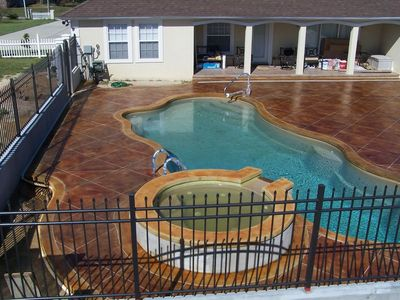 image of acid stained pool deck with a tile pattern.