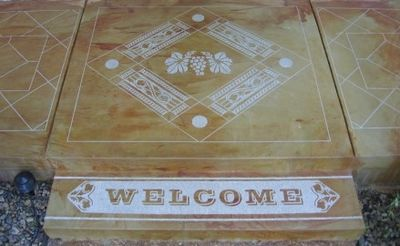 Image of Welcome sign cut into concrete patio.
